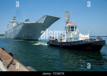 Spanish Navy multi-purpose amphibious assault ship Juan Carlos I (L61), prepares to moor at Naval Base Kiel-Tirpitzhafen, Germany in preparation of exercise Baltic Operations (BALTOPS) 2019, June 5, 2019. BALTOPS is the premier annual maritime-focused exercise in the Baltic region, marking the 47th year of one of the largest exercises in Northern Europe enhancing flexibility and interoperability among allied and partner nations. (U.S. Marine Corps photo by Cpl. Abrey Liggins) - Stock Photo