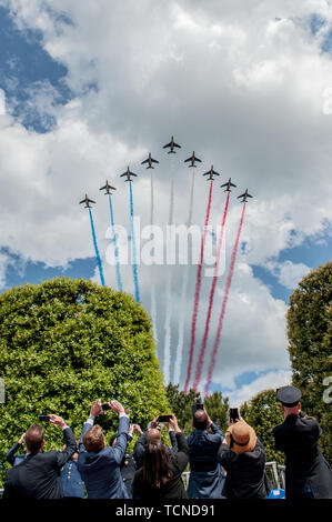 Spectators watch as French aircraft conduct a fly-over at the 75th Anniversary of D-Day at the Normandy American Cemetery and Memorial in Colleville-sur-Mer, France, June 6, 2019.     More than 1,300 U.S. Service Members, partnered with 950 troops from across Europe and Canada, have converged in northwestern France to commemorate the 75th anniversary of Operation Overlord, the WWII Allied Invasion of Normandy, commonly known as D-Day. - Stock Photo