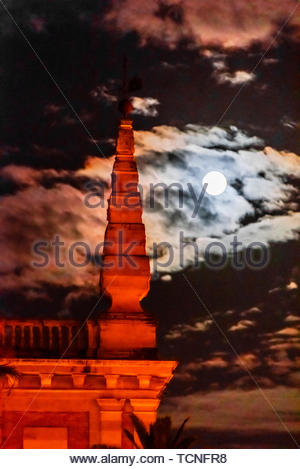 Full moon on Good Friday of Holy Week (Semana Santa), Seville, Andalusia, Spain. - Stock Photo
