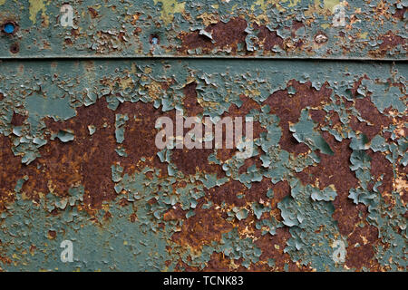 Old Rusty sheet metal with peeling blue paint - Stock Photo