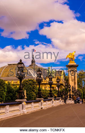 Pont Alexandre III (bridge) across the Seine River. The bridge is the most ornate in the city. The Grand Palais is in the background. Paris, France. - Stock Photo