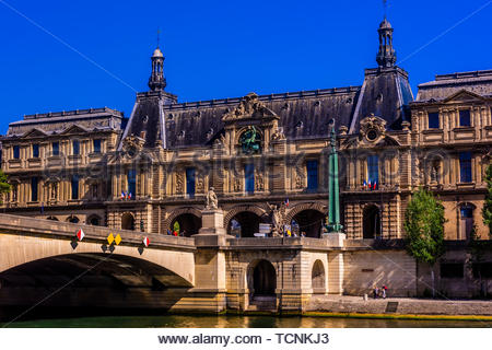 View of the Louvre Palace from the River Seine, Paris, France. - Stock Photo