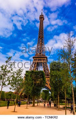 The Eiffel Tower from Champ de Mars Park, Paris, France.  The Eiffel Tower is the most famous landmark in Paris. - Stock Photo