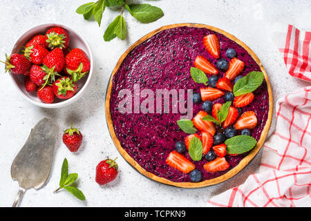 Berry cheesecake on white table top view. - Stock Photo