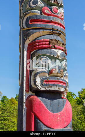 The iconic British Columbia Crown Colony Totem Pole in the Valley Gardens at Virginia Water, Windsor Great Park, in Surrey/Berkshire, UK - Stock Photo