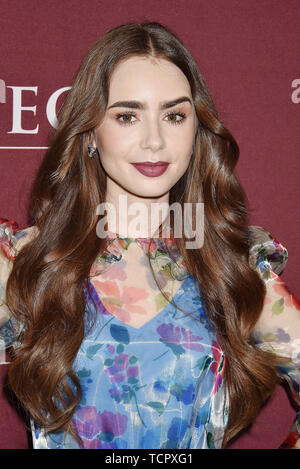 LOS ANGELES, CA - JUNE 08: Lily Collins attends Les Misérables Photo Call at Linwood Dunn Theater on June 08, 2019 in Los Angeles, California. - Stock Photo