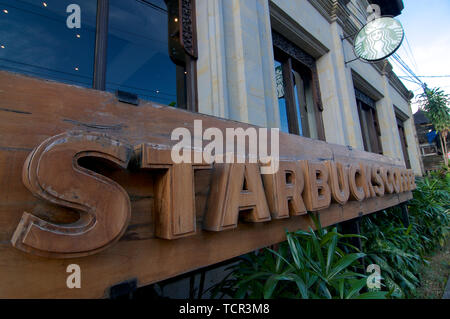 Ubud, Bali, Indonesia - 17th May 2019 : Picture of a wooden Starbucks Coffee signage located in the village of Ubud in Bali, Indonesia - Stock Photo