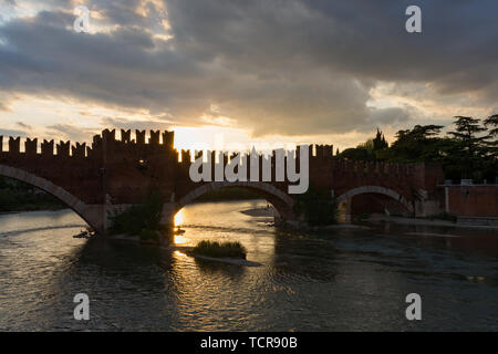 The Castelvecchio bridge, also known as the Scaliger bridge, is a Verona bridge on the Adige river, part of the fortress of Castelvecchio, considered  - Stock Photo
