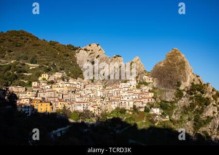 Ancient village of Castelmezzano at sunset. Dolomites of Basilicata mountains called Dolomiti Lucane.  Basilicata region, Italy - Stock Photo