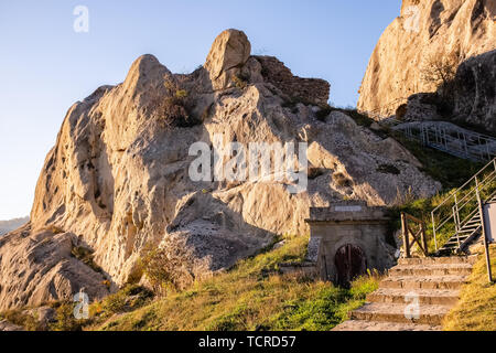 Ruins of Castelmezzano castle and gate of water reservoir. Dolomites of Basilicata mountains called Dolomiti Lucane. Basilicata region, Italy - Stock Photo