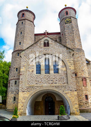 Collegiate Church of Sts. Chrysanthus and Daria in Bad Muenstereifel, North Rhine-Westphalia Germany, exterior westwork view against an overcast sky - Stock Photo