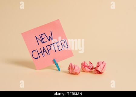Handwriting text New Chapter. Conceptual photo Starting ultimately something goals created in your mind Plain note paper and stationary placed above s - Stock Photo