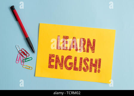 Handwriting text Learn English. Conceptual photo gain acquire knowledge in new language by study Plain cardboard and writing equipment placed above pa - Stock Photo