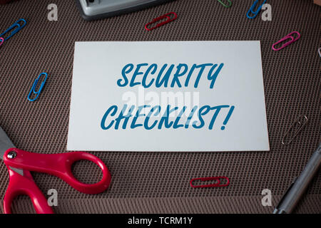 Text sign showing Security Checklist. Business photo showcasing Protection of Data and System Guide on Internet Theft Scissors and writing equipments  - Stock Photo