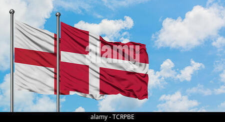 England and Denmark flag waving in the wind against white cloudy blue sky together. Diplomacy concept, international relations. - Stock Photo