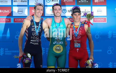 Australia's Jacob Birtwhistle (centre) celebrates winning the Men's Triathlon with USA's Matthew McElroy (left) taking silver and Spain's Javier Gomez Noya (right) taking bronze , during the 2019 ITU World Triathlon Series Event in Leeds. - Stock Photo