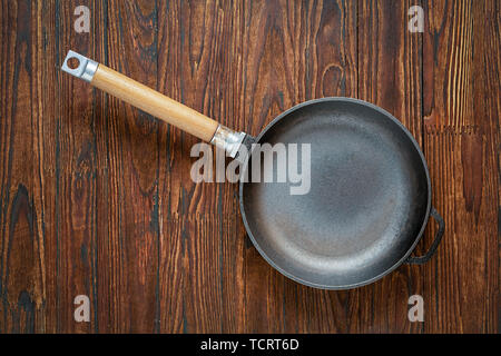 pan, pan on table, cooking, kitchen, stainless steel, baking, pan, round Teflon, cooking, cast iron, pan on table, table top, empty frying - Stock Photo