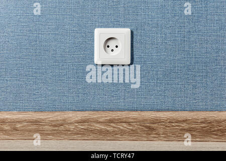 Euro electric outlet type C, electrical point of power in house, on the blue wall background. - Stock Photo