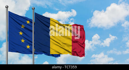 European Union and Chad flag waving in the wind against white cloudy blue sky together. Diplomacy concept, international relations. - Stock Photo