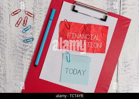Word writing text Financial Regulation. Business photo showcasing aim to Maintain the integrity of Finance System Clipboard paper sheet crushed sticky - Stock Photo