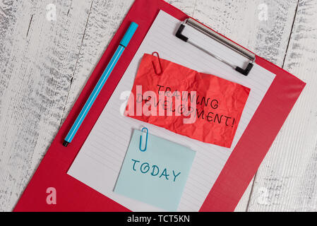 Writing note showing Training Development. Business concept for Learn and Expand skills and knowledge Program Clipboard paper sheet crushed sticky not - Stock Photo