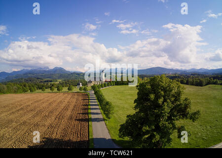 Pilgrimage Church Irschenberg Wilparting with mountain view - Stock Photo