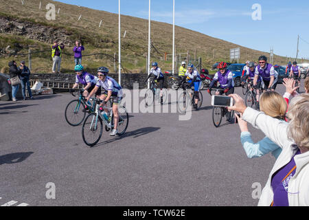 Cystic Fibrosis Fund Raising Cycle Race, May, 12, 2019: Spectators cheer the riders at the finish line of the Cycle 4 CF fund raising ride from Malin  - Stock Photo