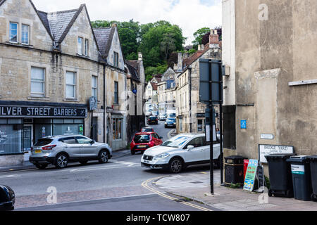 Traffic queued and passing up and down Market Street in Bradford on Avon seen from Silver street - Stock Photo