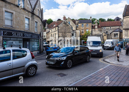 Stationary and very slow moving traffic snarled up at the roundabout in the Wiltshire town of Bradford on Avon where Market Street joins Silver Street - Stock Photo