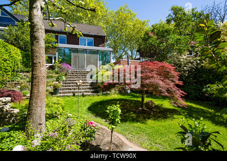 residential house with winter garden, single-family home, row house, garden side, flower garden, rock garden, rockery, outside staircase, perron, natural stone stairs, D-Oberhausen, D-Oberhausen-Sterkrade, Lower Rhine, Ruhr area, North Rhine-Westphalia, NRW - Stock Photo