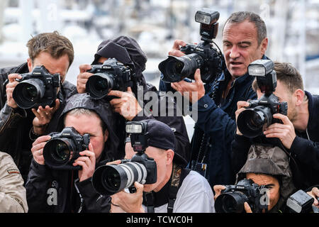 Rain falls in press photographers at the Palais des Festivals on Monday 14 May 2018 during the 71st Cannes Film Festival held at Palais des Festivals, Cannes. - Stock Photo