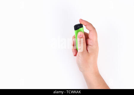 The girl ignites a lighter on a white background. Top view. - Stock Photo