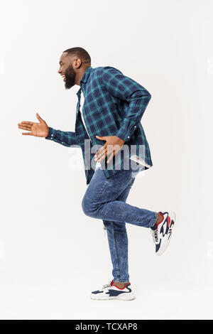 Healthy young black man jogging. Isolated over white background. - Stock Photo