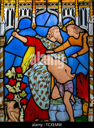 Victorian 19th century stained glass window, Lawshall church, Suffolk, England, UK by Horwood Bros - Abraham and Isaac - Stock Photo