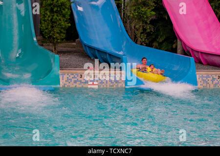 Orlando, Florida. April 07, 2019.  Father and daughter having fun Omaka Rocka. It is a water slide at Aquatica . - Stock Photo