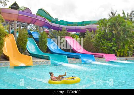 Orlando, Florida. April 07, 2019.  Girl having fun Omaka Rocka. It is a water slide at Aquatica . - Stock Photo