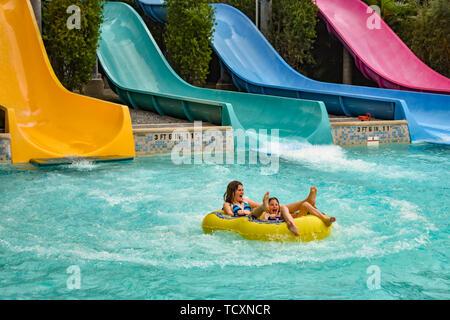Orlando, Florida. April 07, 2019.  Girls having fun Omaka Rocka. It is a water slide at Aquatica . - Stock Photo