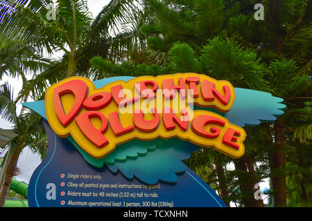 Orlando, Florida. April 07, 2019. Colorful Dolphing Plunge sign at Aquatica water park . - Stock Photo