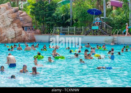 Orlando, Florida. April 07, 2019. Parent and kids enjoying pool with lightblue water at Aquatica water park . - Stock Photo