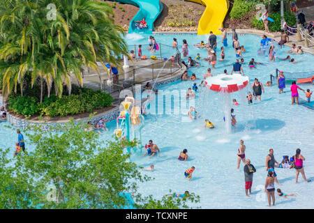 Orlando, Florida. April 07, 2019. Parent and Kids enjoying water play areas at Aquatica water park  . - Stock Photo