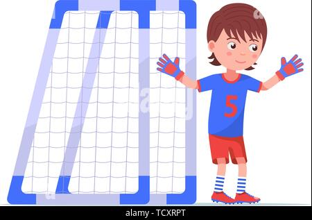 Boy goalkeeper stands next to the football goal - Stock Photo