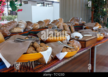 Variety of black and white bread in Turkish hotel - Stock Photo