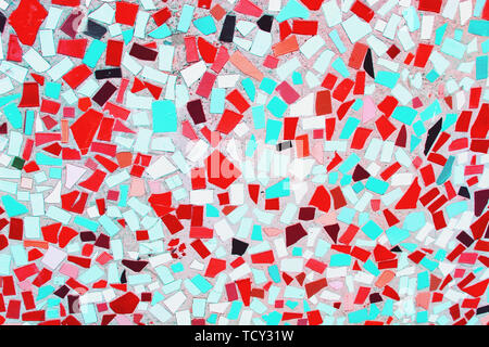 Closeup of trendy coloured mint, red and white abstract mosaic ceramic tiles patterned background - Stock Photo
