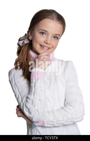 Portrait of smiling little girl wearing warm sweater on white background - Stock Photo