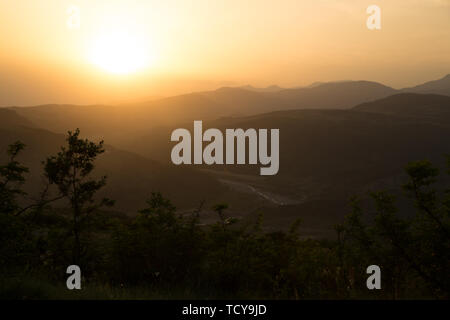 Beautiful landscape in the mountains with the sun at dawn. Mountains at the sunset time. Azerbaijan Caucasus Mountains. Agsu pass. Baskal. Nature - Stock Photo
