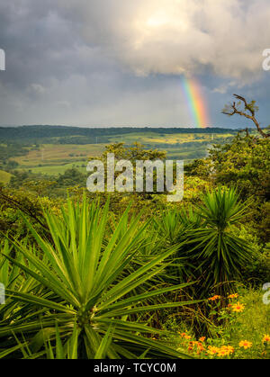 Rainstorm and rainbow over Rincón de la Vieja National Park in Costa Rica - Stock Photo