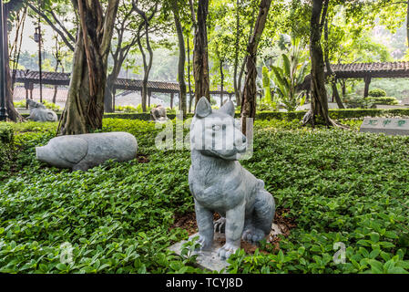 Chinese Zodiac garden statues Kowloon Walled City Park in Hong Kong - Stock Photo
