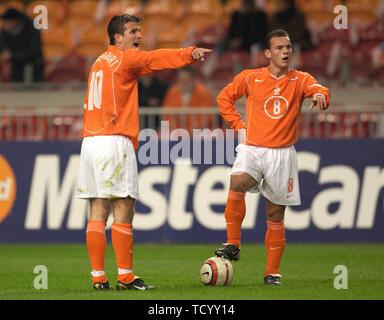 Amsterdam ArenA, Amsterdam Netherlands, 18.2.2004 Football: international friendly, Netherlands (orange) vs USA (white) 1:0 -- Rafael Van der Vart (NED,left), Wesley Sneijder (NED) - Stock Photo