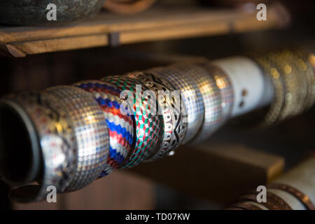 Copper bands handcrafted, traditionally made in Lagich, Azerbaijan. Handmade bands in souvenir shop. - Stock Photo