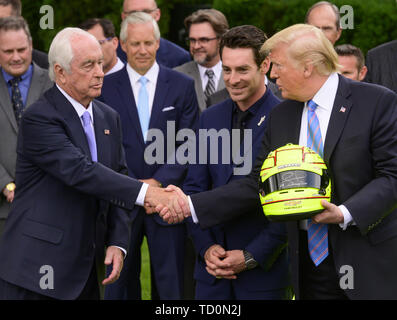 Washington, District of Columbia, USA. 10th June, 2019. United States President Donald J. Trump, right, shakes hands with Roger Penske, left as winning driver Simon Pagenaud, center, looks on as the President greets the 103rd Indianapolis 500 Champions: Team Penske, on the South Lawn of the White House in Washington, DC on Monday, June 10, 2019. The President took some questions on trade, Mexico, and tariffs against China Credit: Ron Sachs/CNP/ZUMA Wire/Alamy Live News - Stock Photo
